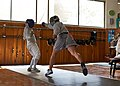 The fencer Alexandros Kanellis performs a flèche against his opponent at Athenaikos Fencing Club.jpg