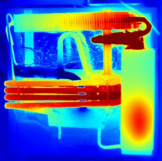 Absorption refrigerator - Thermal image of a domestic absorption refrigerator of a comparable type to the one in the labelled image above. Colour indicates relative temperature: blue=cold, red is hottest. The heat source (7) is contained entirely within the insulation section (6).