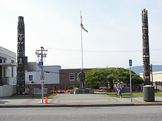 Prince Rupert, British Columbia - Two of the many totem poles in Prince Rupert are situated outside City Hall.