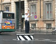 Traffic control in Rome, Italy. This traffic control podium can retract back to road level when not in use.