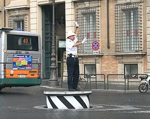 Traffic - Traffic control in Rome, Italy. This traffic control podium can retract back to road level when not in use.