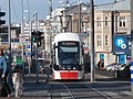 Tram 501 stopped at a Traffic Light at Junction of Tartu mnt and Lubja Tallinn 19 October 2015.jpg