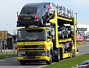 DAF tractor with an auto-transport semi-trailer truck carrying Škoda Octavia cars in Cardiff, Wales