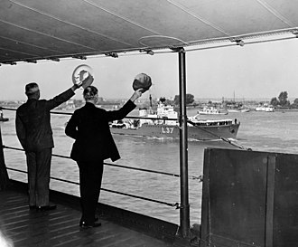Scheldt - U.S. President Harry S. Truman and Secretary of State James F. Byrnes wave at HMS ''Hambledon'' while on board the USS ''Augusta'' on the river Scheldt as they head to the Potsdam Conference on 15 July 1945