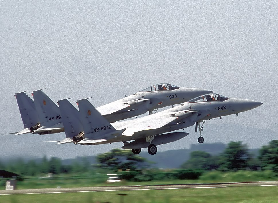 Two JASDF F-15J take off in formation.JPEG
