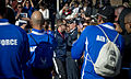 U.S. Airmen applaud as retired U.S. Coast Guard Chief Petty Officer Christopher Skunk carries the torch during the opening ceremony for the inaugural Warrior Games at the Olympic Training Center in Colorado 100510-N-PC102-124.jpg
