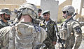 U.S. Army 1st Lt. Chase S. Burnett, right, a platoon leader with the 2nd Battalion, 23rd Infantry Regiment, speaks with Afghan National Army engineers while helping with the transfer of training equipment 130522-A-MX357-035.jpg