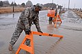 U.S. Army 1st Lt. Vikram Mittal with the 26th Maneuver Enhancement Brigade, places a barrier by the Gurnet Gate Over-sand Road At Duxbury Beach in Duxbury, Mass., March 7, 2013 130307-A-ZZ999-185.jpg