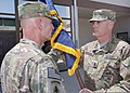 U.S. Army Command Sgt. Maj. David Redmon, right, takes the colors of Combined Joint Interagency Task Force 435 during an assumption of responsibility ceremony at Camp Phoenix, Afghanistan, Aug. 8, 2012 120808-N-UZ772-4008.jpg