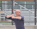 U.S. Coast Guard Petty Officer 3rd Class Christopher Yaw, a public affairs specialist with the 9th Coast Guard District External Affairs Office in Cleveland, prepares to swing at a pitch during his unit's 130731-G-KB946-008.jpg