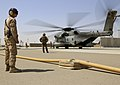 U.S. Marine Corps Cpl. Justin Duran, left, a line safety noncommissioned officer with Marine Wing Support Squadron (MWSS) 274, supervises Marines refueling a CH-53E Super Stallion helicopter at a forward arming 140903-M-EN264-075.jpg