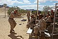 U.S. Marine Corps Sgt. Maj. Roger F. Griffith, sergeant major for Combat Logistics Battalion 6, 2nd Marine Logistics Group, demonstrates shooting positions during the battalion Enhanced Marksmanship Program 130507-M-Zb219-003.jpg