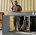 U.S. Navy Builder 1st Class John Van Doren, left, and Navy Steelworker 1st Class Jay Canton, both with Naval Mobile Construction Battalion 15, prepare duct work for a project supporting Combined Special 130527-A-CV700-014.jpg