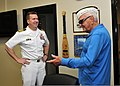 U.S. Navy Capt. Douglas Peabody, left, the commanding officer of the U.S. Pacific Command Joint Intelligence Operations Center, meets with Ewalt Shatz, a survivor of the attack on Pearl Harbor, before a Pearl 131206-N-QN361-016.jpg