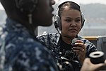U.S. Navy Operations Specialist Seaman Lorraine Cervantes, right, mans a sound-powered telephone aboard amphibious command ship USS Blue Ridge (LCC 19), flagship of the U.S. 7th Fleet, as the ship leaves 120807-N-YF014-030.jpg