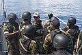 U.S. Navy Petty Officer 2nd Class John A. Wilcox, center, a maritime interdiction operations expert, briefs members of a Seychelles Coast Guard boarding team before an illegal fishing scenario Nov. 13, 2013, off 131113-N-EZ054-057.jpg