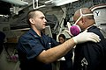 U.S. Navy Quartermaster 1st Class Robert Persi, left, conducts a respirator fit test on Chief Damage Controlman Severino Esteller aboard the guided missile destroyer USS William P. Lawrence (DDG 110) Aug. 30 130830-N-ZQ631-062.jpg