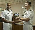 U.S. Navy Rear Adm. Frank Ponds, left, the commander of Navy Region Hawaii and Naval Surface Group Middle Pacific, trades gifts with Japanese Maritime Self-Defense Force (JMSDF) Rear Adm. Hideki Yuasa 130516-N-WX059-028.jpg