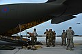 U.S. Soldiers assigned to the 82nd Airborne Division work with Royal Air Force loadmasters to fix the ramp on a Royal Air Force C-130J Hercules aircraft before loading a high-mobility artillery rocket system 130429-F-IO684-754.jpg