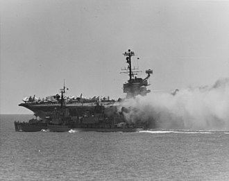 1967 USS Forrestal fire - Image: USS Rupertus (DD 851) stands by to assist the burning USS Forrestal (CVA 59), 29 July 1967 (USN 1124775)