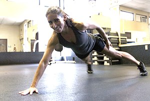 Push-up - A U.S. Army employee demonstrates a one-arm push-up in an extended position.