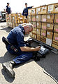 US Navy 030321-N-9693M-004 Aviation Ordnanceman 3rd Class Colby Willett uses a barcode scanner and printer to inventory cases of ammunition at the Naval Air Station's weapons department.jpg