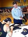 US Navy 030429-N-8527S-001 Engineman 3rd Class Justin Garrett watches as Godsmack's lead singer Sully Erna autographs.jpg