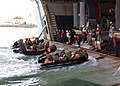 US Navy 040417-N-0009S-001 USS Boxer (LHD 4) well deck and deck department personnel help boat crews from 1st Battalion, 3rd Marines, practice small boat departures and arrivals.jpg