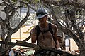 US Navy 050116-N-6954B-001 Steelworker Constructionman Joseph Perkovich, assigned to Naval Mobile Construction Battalion Seven (NMCB-7), Air Detachment, carries debris left over from the destruction that the tsunami caused to a.jpg
