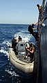 US Navy 050626-N-0905V-048 Sailors assigned the boarding team aboard the guided missile cruiser USS Antietam (CG 54), lower themselves to the starboard Rigid Hull Inflatable Boat.jpg