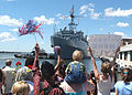 US Navy 050925-N-3725R-166 Friends and family members watch as the amphibious transport dock USS Nashville (LPD 13) returns to Naval Station Norfolk.jpg