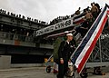 US Navy 051108-N-0050T-159 Sailors depart the nuclear-powered aircraft carrier USS Nimitz (CVN 68) after arriving on board Naval Air Station North Island, Calif.jpg