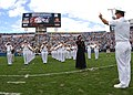 US Navy 051113-N-1126D-004 Navy Band Southeast performs the National Anthem as U.S. Army Staff Sgt. Erica Russo sings the anthem at the Jacksonville Jaguars pre-game ceremony.jpg