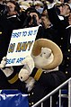 US Navy 051203-N-0295M-020 U.S. Naval Academy mascot Bill the Goat holds up a sign signifying the Navy was the first to break the tie and win 50 games in the Army vs. Navy rivalry at the 106th Army vs. Navy Football game.jpg