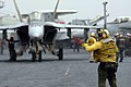 US Navy 051205-N-4321F-011 An Aviation Boatswain's Mate directs an F-A-18E Super Hornet.jpg
