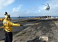 US Navy 060203-N-0716S-006 Aviation Boatswain's Mate Airman Jonathan Sandoval directs a SH-60 Seahawk Helicopter as it takes-off from the amphibious assault ship USS Tarawa (LHA 1) during a vertical replenishment (VERTREP.jpg