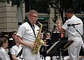 US Navy 070528-N-6914S-027 Musician 1st Class Adam Grimm performs a saxophone solo with the U.S. Navy Band during a Memorial Day concert at the Navy Memorial in Washington, D.C.jpg