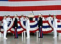 US Navy 070914-N-8825R-112 Aviators from Training Air Wing (TRAWING) 1 perform the passing of the national ensign honors during a change of command ceremony.jpg