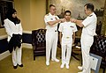 US Navy 070925-N-0696M-055 Chief of Naval Operations (CNO) Adm. Mike Mullen and Rear Adm. Alan Baker, Deputy Chief of Navy Chaplains, commission Ensign Asif Balbale in the Chaplain Corps as his wife looks on.jpg