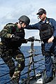 US Navy 071126-N-9123L-008 Chief Gunner's Mate Paul Beinlich assists Gunner's Mate 2nd Class Robert Wheeler during a.jpg