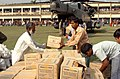 US Navy 071203-N-1831S-131 U.S. Marines and Sailors from the amphibious assault ship USS Kearsarge (LHD 3) and Bangladeshi citizens unload food and supplies from a CH-53E Super Stallion.jpg