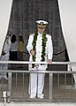 US Navy 071207-N-8623G-126 Adm. Timothy J. Keating, commander, U.S. Pacific Command throws flower pedals into the USS Arizona Memorial well.jpg