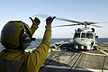 US Navy 080215-N-2420K-139 Boatswain's Mate 3rd Class Christian Anton, a landing signalman enlisted, gives hand signals to the pilot of an SH-60B Seahawk.jpg