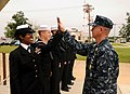 US Navy 090331-N-2070C-001 Master Chief Petty Officer of the Navy (MCPON) Rick West high-fives Naval Air Station Whiting Field Sailor of the Year Yeoman 1st Class Aritha Gregory.jpg
