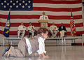 US Navy 090717-N-3013W-125 Antonio Rios plays on the hangar bay floor of Patrol Squadron (VP) 16 while his grandfather, Lt. Cmdr. Paul Nix Jr. delivers his retirement address from the podium.jpg