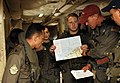 US Navy 090806-N-2725D-010 Lt. Clay Waddill, assigned to Patrol Squadron (VP) 45, explains the flight plan for his P-3 Orion Aircraft to visiting Royal Brunei Air Force officers.jpg