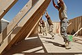 US Navy 090925-N-9623R-050 Seabees assigned to Naval Mobile Construction Battalion (NMCB) 22, work on a construction project with the U.S. Army 4th Engineer Battalion.jpg