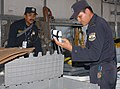 US Navy 100623-N-4971L-021 El Salvador civilian and military defense personnel conduct a practice warehouse search for drugs, weapons and contraband.jpg