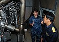 US Navy 100721-N-3570S-058 mdr. Kris Doyle commanding officer of the littoral combat ship USS Freedom (LCS 1), shows Rear Adm. Kazuki Yamashita the ship's Rolls-Royce engine.jpg