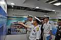 US Navy 100725-N-8951S-106 Rear Adm. Michael Shatynski, deputy commander of U.S. Naval Surface Forces, listens as Republic of Korea navy Rear Adm. Byeung Kweon Lee discusses advances in military technology.jpg